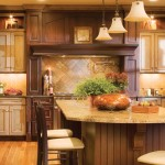 A stunning Mantel Hood is the focal point of this kitchen.