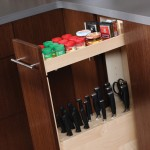 A shallow tray above the cutlery block offers convenient storage for small items and spices.