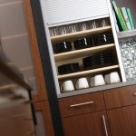 Including a tall tambour cabinet provides centralized storage while adjustable shelves, which are precisely positioned for maximum kitchen organization.