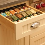 Keep your spices at your fingertips in this convenient, wood drawer spice rack next to an oven or baking center.