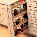 Small spaces offer a surprising amount of spice storage with a vertical pull-out spice rack.