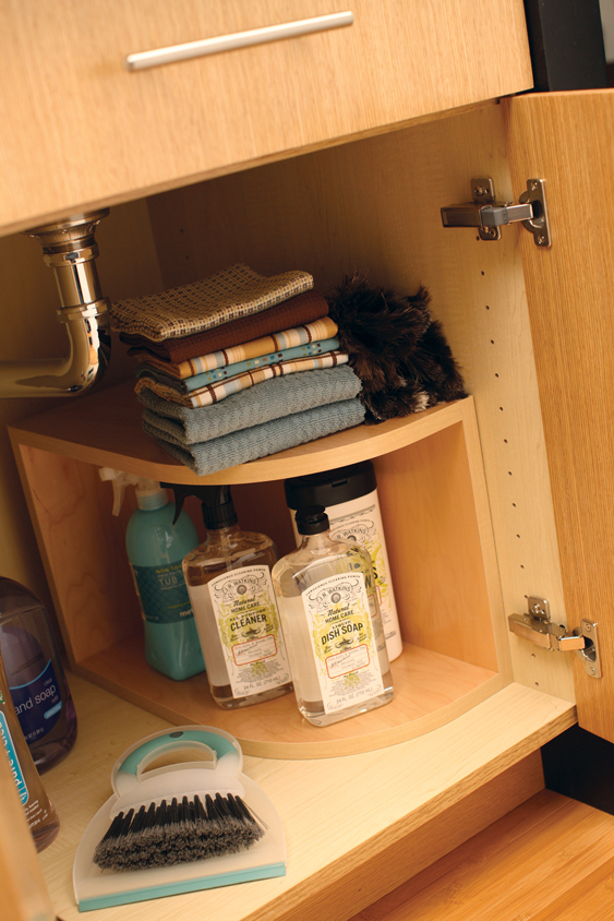 A Two Tiered Shelf Provides Extra Storage On Either Side Of The Plumbing  Fixtures.