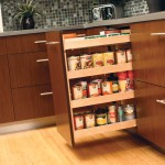 This pull-out pantry neatly stores row after row of canned goods within a small space, inside a base cabinet or wall cabinet.