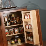 A can rack on the door keeps pantry goods easily accessible. Available in both base and wall cabinets.
