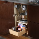 A heavy mixer can be lifted with ease to countertop level and conveniently stored in its own cabinet.
