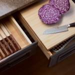 A slotted Drawer Knife Holder keeps blades sharp, while a chop block is conveniently located in the adjacent drawer. The chopping block has storage space below and is removable from the drawer for countertop use.