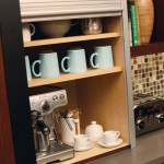 Our popular, tall, metal tambour door rolls-up to reveal a convenient coffee center with cups, saucers and sugar stored close at hand.