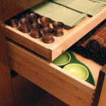 A shallow roll-out on top of a deep drawer adds another level of customized storage.