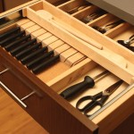 The slotted knife holder can be hidden below a two-tier cutlery tray for maximum drawer use.