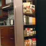 A tall pantry (available with wood or wire shelves) provides an amazing amount of storage on full-extension glides.