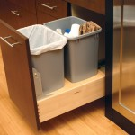 A convenient pull-out with double bins for trash and recycling is one of CKB's  most popular kitchen cabinet options.