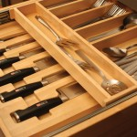 In this two-tier cutlery drawer, silverware is organized on top and the J.A. Henckels® knives are tucked discreetly and safely below. The carved cutlery insert is designed specifically for the Henckels knife set from Dura Supreme.