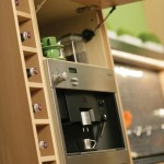 Design a beverage center where guests can help themselves to coffee, espresso or bottled waters.