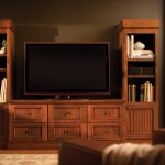 """Entertainment cabinetry from Dura Supreme can be designed to integrate seamlessly with furniture and other cabinetry within the home.  Designer Cabinetry shown with """"Montego"""" door style in Knotty Alder with Heavy Patina """"D"""" finish."""