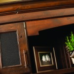 Speaker cloth can be specified in place of any door panel, so that speakers and the sound system can be fully integrated into the cabinetry.