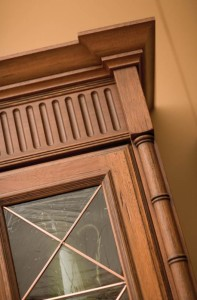 An elaborately designed four-piece decorative crown molding treatment